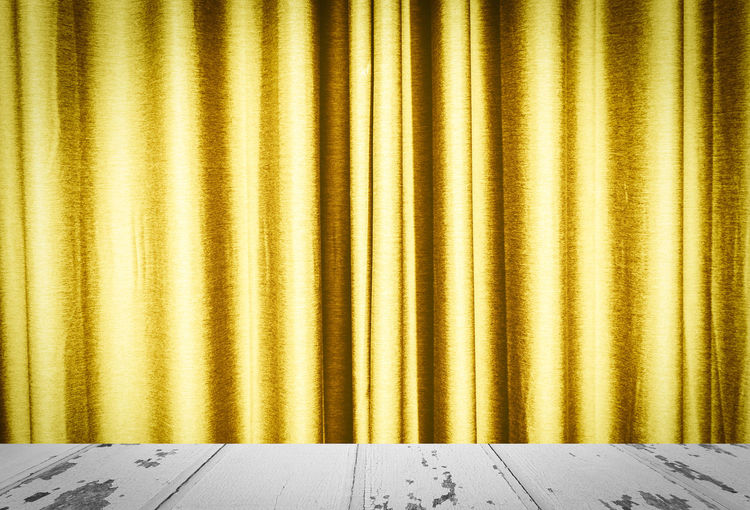 Gold colored curtain of stage theater