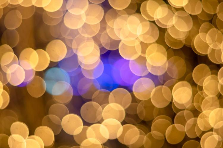 Christmas Bokeh gold light circle background. Bokeh Christmas Lights Decoration Abstract Electric Light Design Light No People Lighting Equipment Lens Flare Full Frame Backgrounds Light - Natural Phenomenon Night Shape Pattern Defocused Geometric Shape Circle Glowing Illuminated
