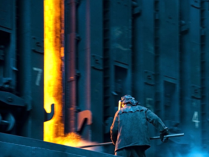 Worker Working At Coke Oven In Factory
