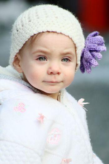 Cute baby girl standing on footpath