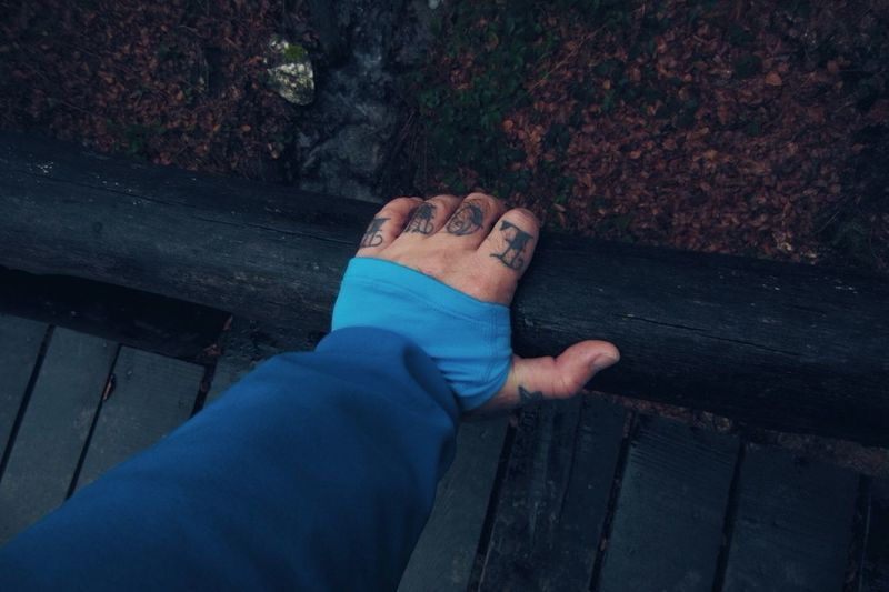 Cropped Image Of Hand With Love Tattoo On Fingers