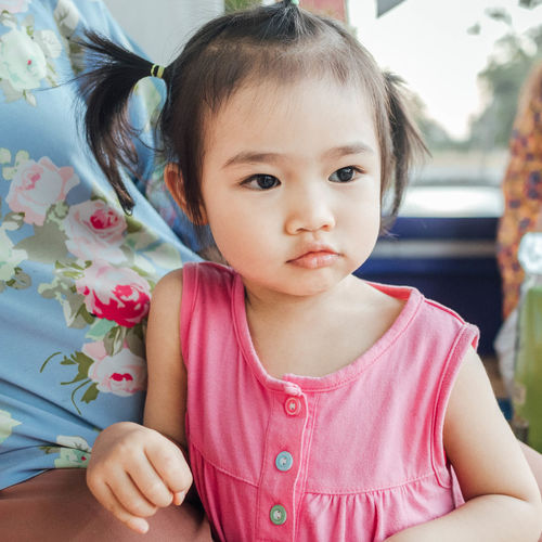Childhood Close-up Cute Day Elementary Age Front View Girls Indoors  Innocence Looking At Camera Portrait Real People Sitting Toddler  Two People