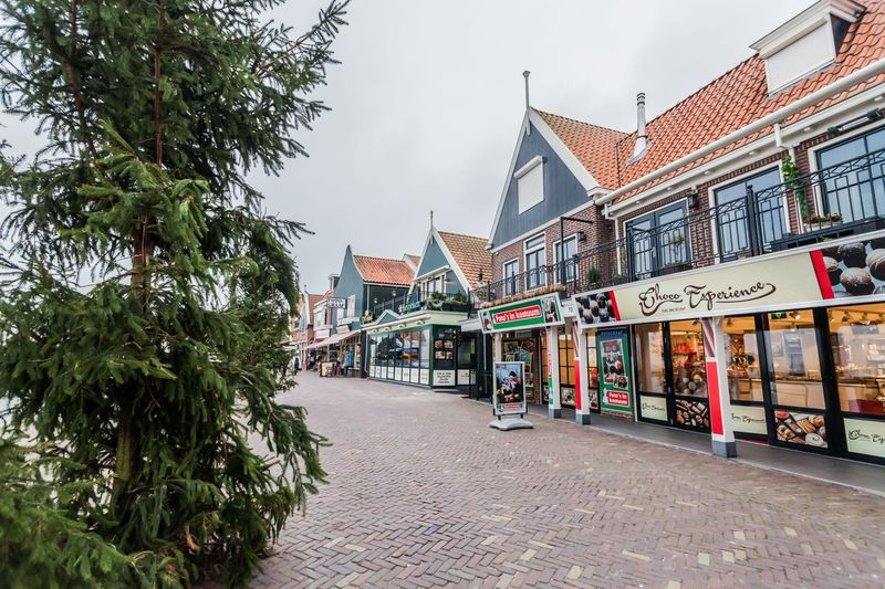 Holiday in Holland - Cold raining wet winter in Volendam Amsterdam Architecture Asian  Bridge Business Capital Church Dutch Editorial  European  Flood Heritage Holland Netherlands Relax Seaside Tourist Vacation Volendam Volendam Netherland Wind Winter
