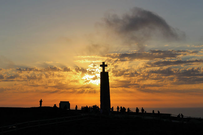 Repost Sunset 2015 . Eye4photography  EyeEm Best Shots EyeEm EyeEm Nature Lover EyeEmBestPics Golden Hour Sky And Clouds Sunset Silhouettes Sunset_collection Sunsetporn Sunsets Seaside Cliffside Cross People People Watching People Photography Colors EyeEm Gallery Taking Photos at Cabo Da Roca Portugal