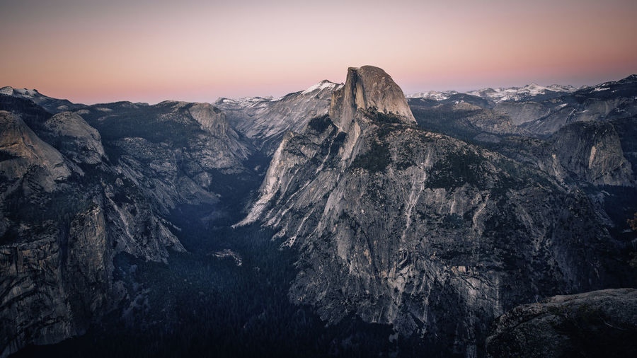 A view of Half Dome during sunset in Yosemite National park Mountain Peak No People Cliff Landscape Environment Mountain Range Tranquility Nature Tranquil Scene Rock Sky Beauty In Nature Mountain Scenics - Nature Sunset Yosemite National Park Half Dome