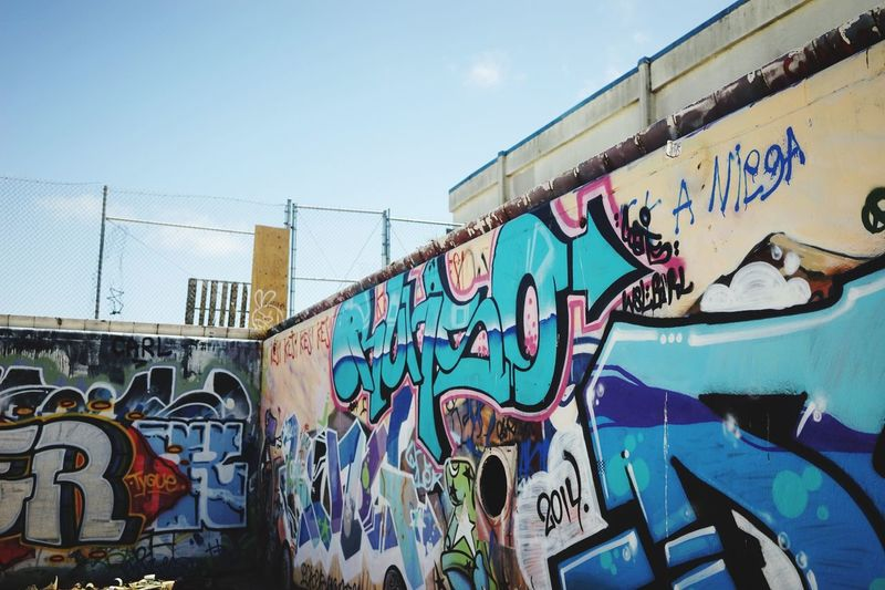 Low angle view of graffiti wall