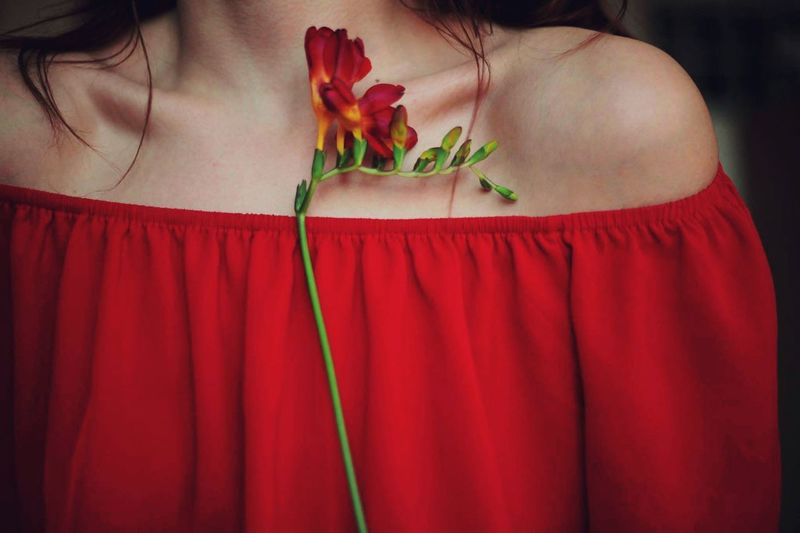 Midsection Of Woman Wearing Red Off Shoulder With Flowers