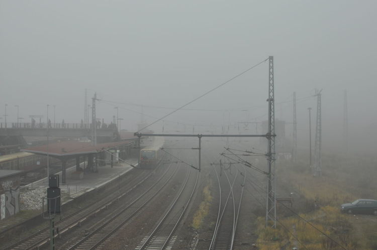 Berlin Built Structure Cable Cold Temperature Day Electricity  Electricity Pylon Fog High Angle View Nature No People Outdoors Power Line  Rail Transportation Railroad Track Sky Transportation Warschauer Brücke