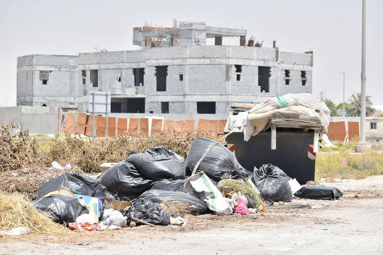 Garbage against buildings in city