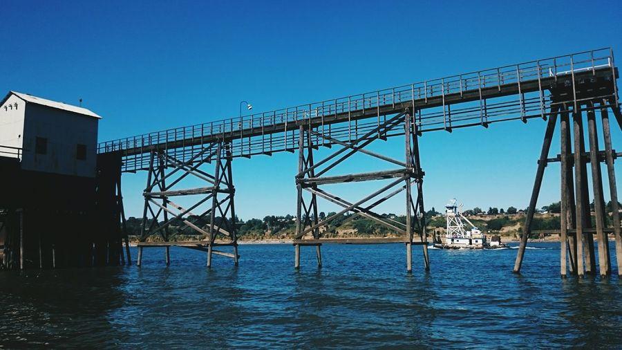 Low Angle View Of Bridge Over Calm Sea