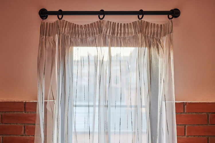 View of curtain by window at home