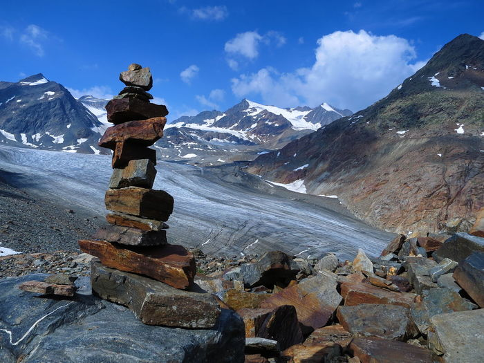 Stacked rocks against mountains during winter