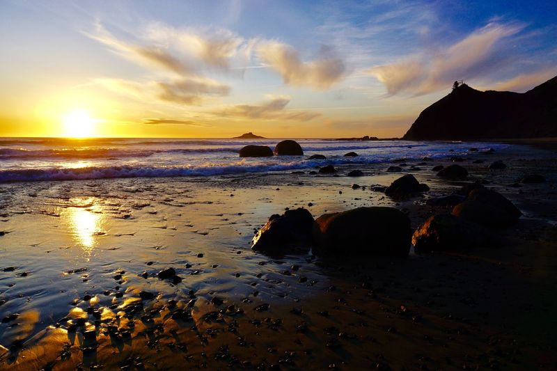 Water Sea Sky Beach Sunset Land Beauty In Nature Scenics - Nature Cloud - Sky Tranquil Scene Tranquility Rock Horizon Over Water Nature Rock - Object Horizon No People Sand Idyllic