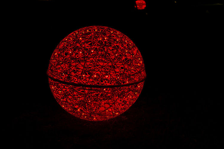 Shine bright like an universe Red Illuminated No People Black Background Night Sphere Copy Space Close-up Studio Shot Lighting Equipment Shape Dark Indoors  Glowing Circle Cut Out Light - Natural Phenomenon Decoration Electric Light Light Christmas Decoration Led Lights  Abstract Universe