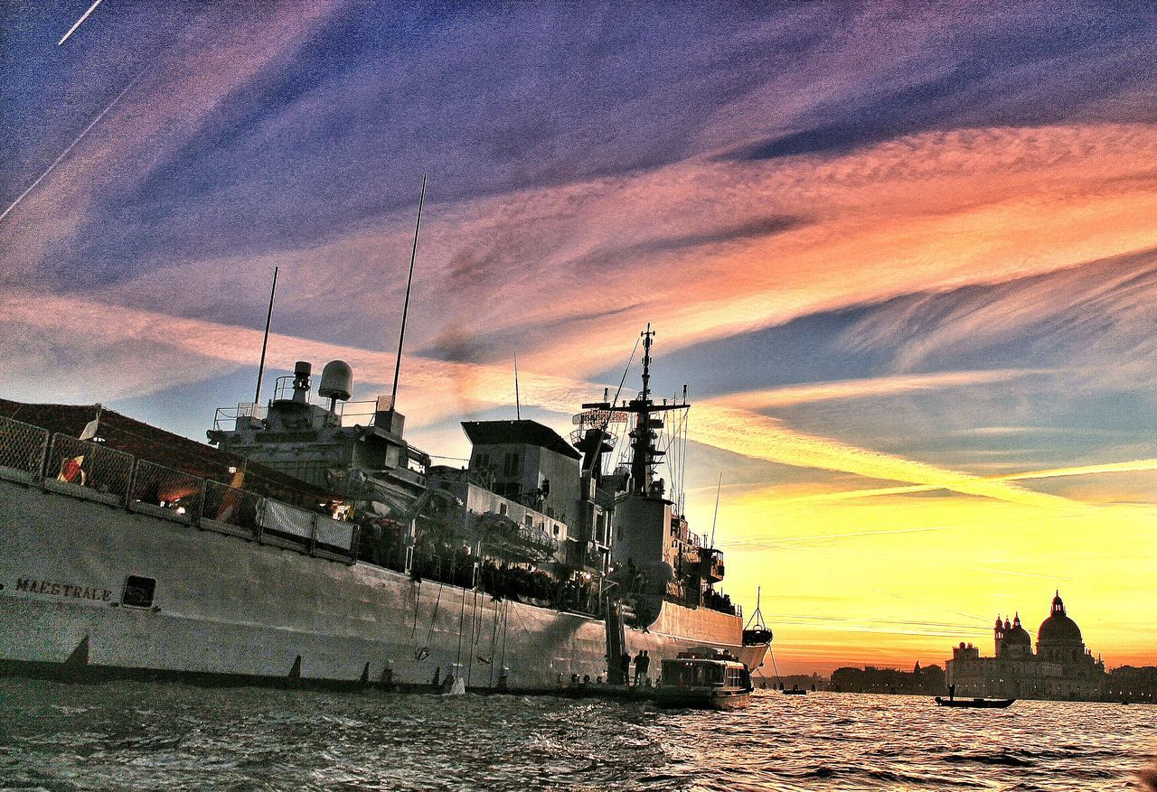 nautical vessel, sunset, sky, transportation, water, mode of transport, waterfront, sea, cloud - sky, built structure, architecture, outdoors, no people, building exterior, nature, military, mast, sailing, day