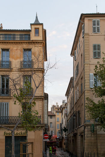 High section of building at Cours Mirabeau, Aix-en-Provence Architecture Building Exterior Built Structure City City Life Cloud - Sky Day Incidental People Old Town Outdoors Residential Building Residential District Residential Structure Sky Spire  The Way Forward Town Window