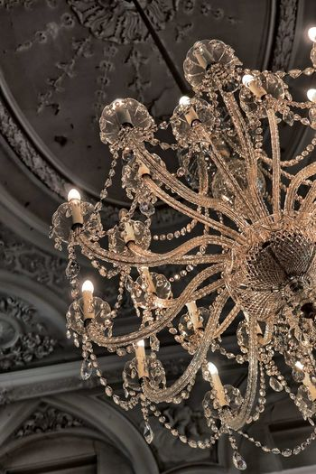 Low angle view of illuminated chandelier in building