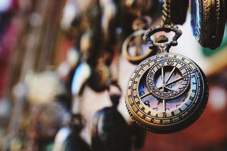 Close-up of antique pocket watch