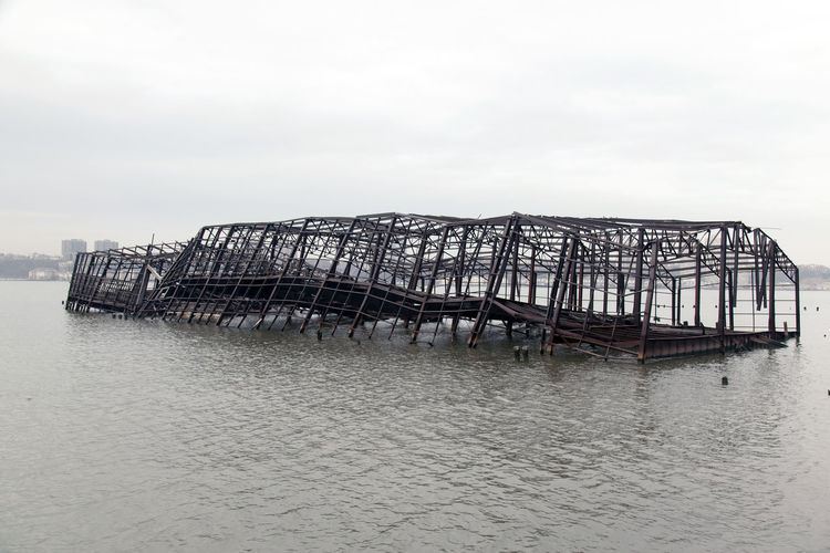 Collapsed metal built structure of a pier in the river Architecture City Iron Pier Abandoned Architecture Built Structure Collapsed Day Design Falling Structure Nature No People Outdoors River Scenics Sea Sinking Sinking Pier Sky Stilt Urban Water Waterfront EyeEmNewHere