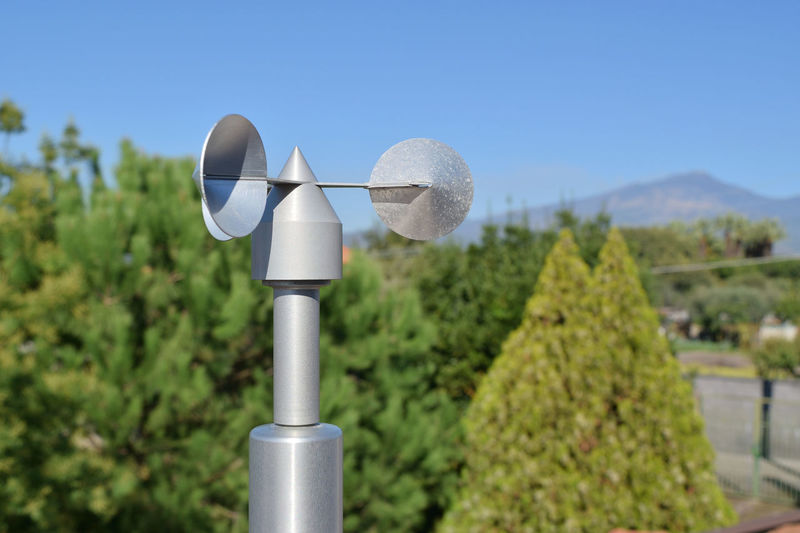 Telephone pole against clear sky