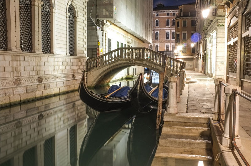 Resting Gondolas Architecture Boat Bridge Building Building Exterior Canal Gondola Gondola Gondole In Venice Mode Of Transport Moored Nautical Vessel Night Night Photography Nightphotography Steps Still Life Street Photography Streetphotography Transportation Venezia Venice Venice, Italy Water Waterfront
