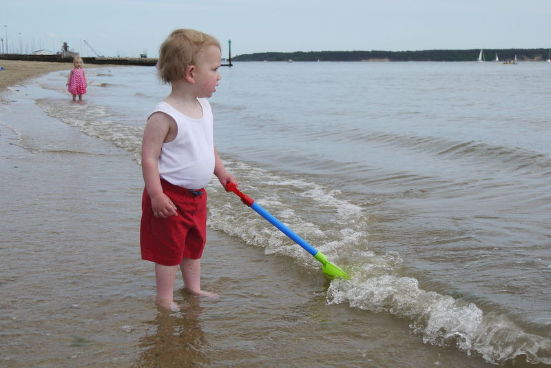 EyeEm Selects Water Children Only Boys One Boy Only Child Wet One Person Sea Beach Males  Childhood People Standing Full Length Blond Hair Fishing Net Outdoors Day Sky Sand Pail And Shovel Beach Photography