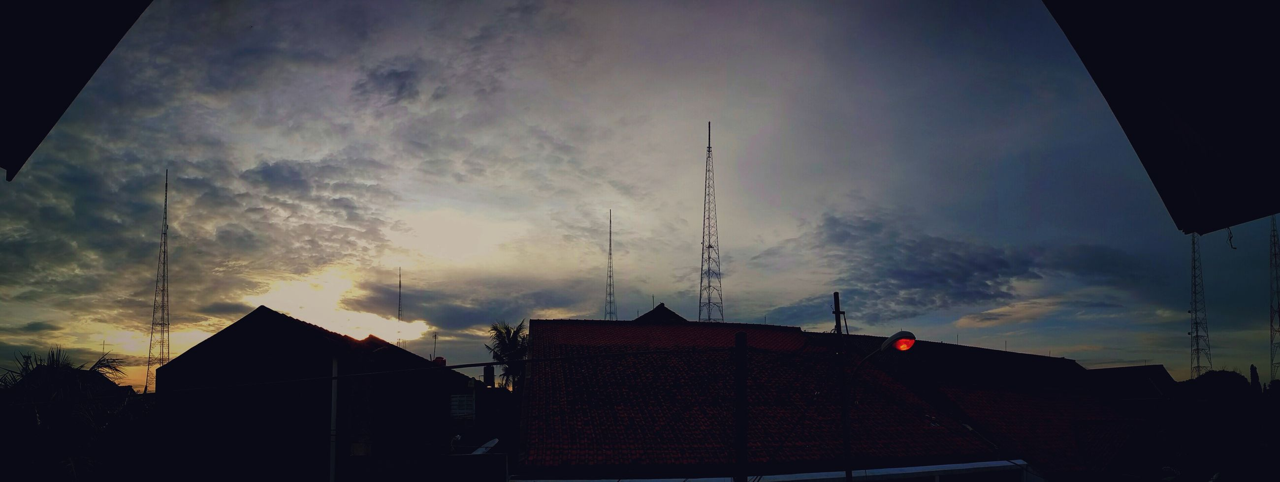 silhouette, architecture, built structure, building exterior, low angle view, sky, sunset, cloud, high section, cloud - sky, outline, dark, electricity pylon, outdoors, power line, power supply, no people, cloudy