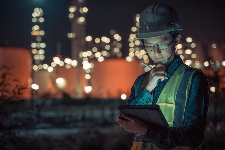 Young man using smart phone at night