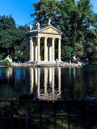 Reflection 🏛 Tree Architecture Built Structure Architectural Column Water Travel Destinations Building Exterior Famous Place Reflection Tourism Park - Man Made Space History Monument Outdoors Surface Level In Front Of Blue Day The Past National Landmark Greek Temple