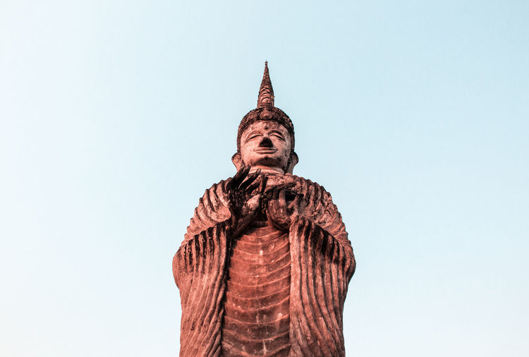 Low angle view of statue of temple against clear sky
