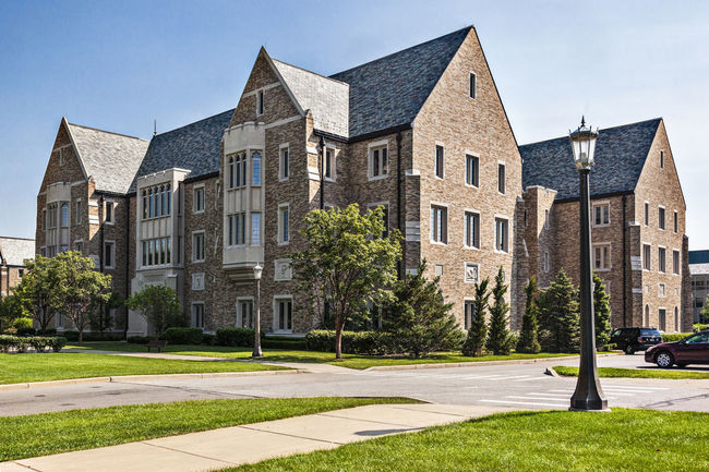 University of Notre Dame USA Culture Green Knowledge Religion Building Campus Christian Color Education Famous Green Grass Lawn Science And Technology Sunny Day Tree Blue Sky Horizontal Composition Outdoor University Of Notre Dame USA
