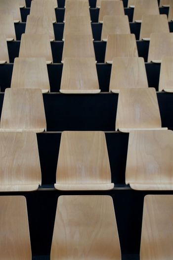 Full Frame Shot Of Wooden Chairs In Stadium