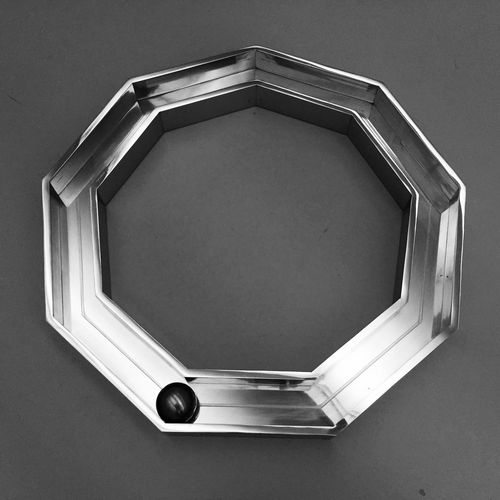 Close-up of hexagon shape metal on table