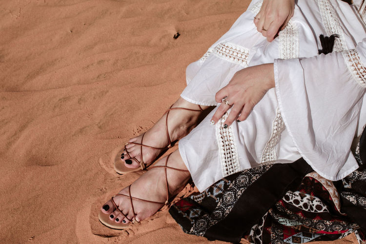 close-up hands with sand of stylish beautiful woman in desert in white outfit Shoe Human Body Part Adult Women Low Section Body Part High Angle View Human Leg People Sitting Clothing Land Sandal Sand Fashion Real People Lifestyles barefoot Human Foot Couple - Relationship Beautiful Woman Adventure Outdoors Summer Desert Travel Nature Woman Stylish Girl Young Adult Fashion Feet Legs Style Lady Accessories Traveling Trip Hot Tourism Traveler Tourist Model Africa Closeup Explorer Beautiful Vacations Trend