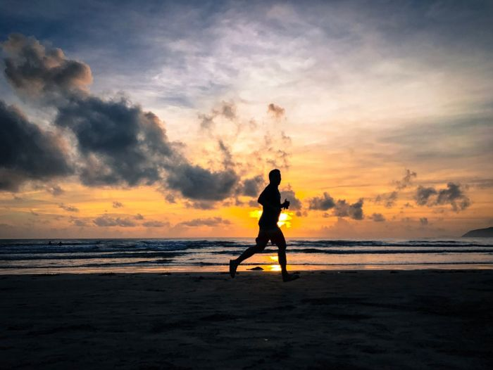 Running Man EyeemPhilippines EyeEm Best Shots EyeEmNewHere Beach Silhouette Sea Cloud - Sky Nature Scenics Beauty In Nature One Person Real People Outdoors Runningman Live For The Story Be. Ready.