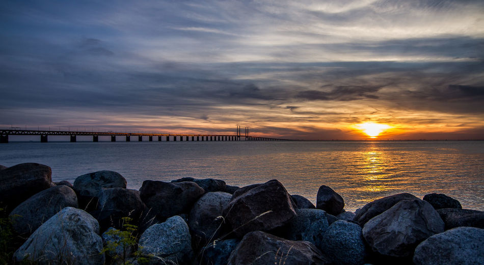 Going to the sun EyeEmNewHere Architecture Beach Beauty In Nature Bridge Built Structure Cloud - Sky Day Dramatic Sky Groyne Horizon Over Water Nature No People Outdoors Pebble Beach Rock - Object Rocks Scenics Sea Sky Stones Sunset Travel Destinations Water öresundsbron EyeEmNewHere