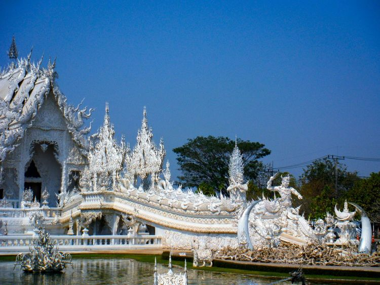 The white temple Wat Rong Khun Chiang Rai Thailand White Temple White Temple Thailand Chinese Art Asian Culture Asian Art Asian Architecture Chinese Architecture Chinese Palace Architecture_collection Architectureporn Architecture Photography Temple Temple Entrance Chiang Rai, Thailand Chiang Rai | Thailand Detail Ornate Ornate Design Lines And Curves White Collection Beautiful Temple Stunning