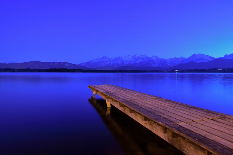 Landing Stage by Hopfen Lake at Blue Hour and Mountain Range in Afterimage Water Mountain Sky Lake Tranquility Beauty In Nature Scenics - Nature Tranquil Scene Blue Wood - Material No People Reflection Nature Pier Idyllic Mountain Range Clear Sky Non-urban Scene Copy Space Longtimeexposure Blue Hour Landscape Landing Stage EyeEm Nature Lover EyeEm Selects Silence Of Nature Silent Moment Travel Photography View Lakescape Landscape_photography Panorama Bavarian Alps Atmospheric Mood Atmospheric Nature