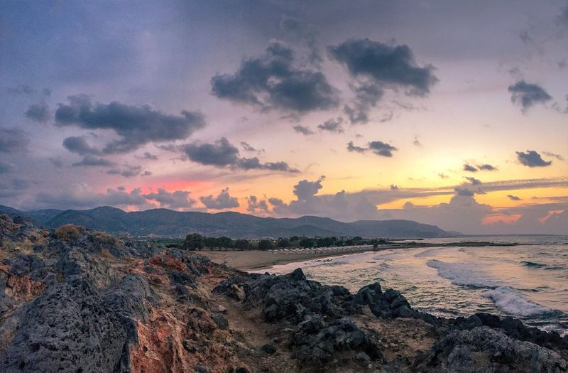 Sunset at the beach Mountain Range Panorama Meditation Place Travel Sunset Sky Cloud - Sky Beauty In Nature Scenics - Nature Tranquility Sea Water Tranquil Scene Beach Land Nature No People Idyllic Outdoors Orange Color Dramatic Sky Environment