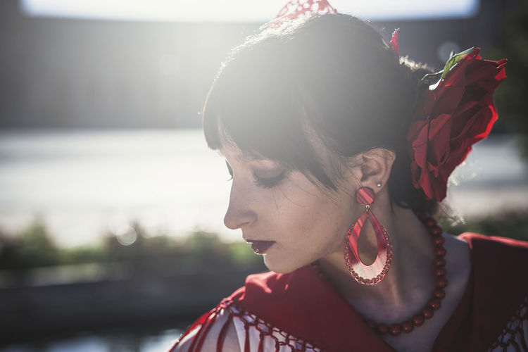 Close-Up Of Young Woman In Traditional Clothes Outdoors