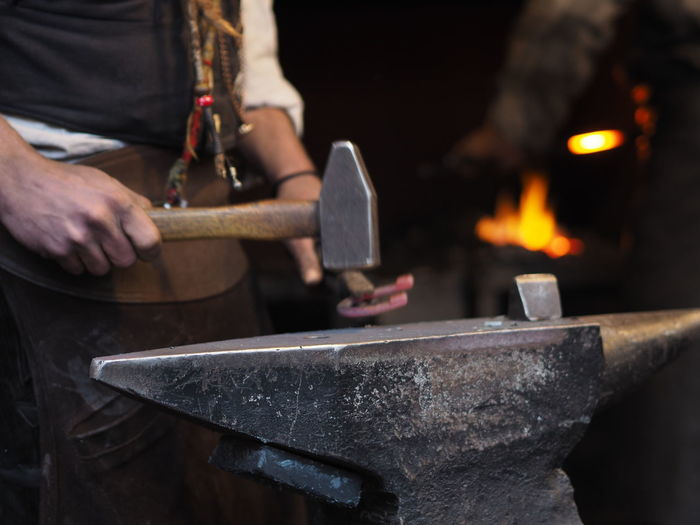 Heat - Temperature Holding Work Tool Fire Hand Tool Burning Blacksmith  Midsection Tool Occupation Hammer Fire - Natural Phenomenon Flame Real People Metal Nature Men One Person Human Hand Hand Metal Industry Iron - Metal Hitting