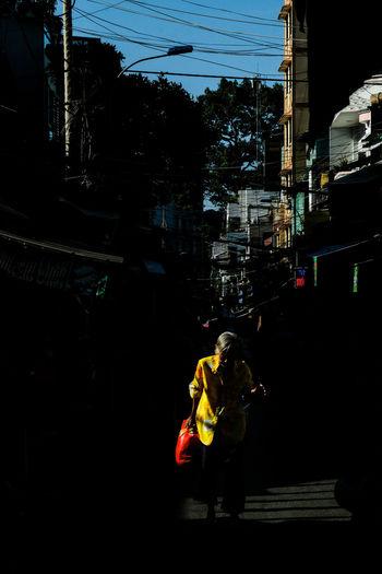 Rear view of woman walking on street in city
