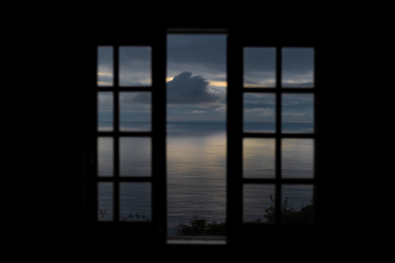 VIEW OF SEA THROUGH WINDOW