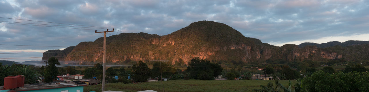 """Panorama of Vinales Valley, as seen from the roof terrace of """"our"""" casa After Sunrise Bogotes Cable Cloud - Sky Cuba Cuba Collection Day Electricity  Mountain Nature No People Outdoors Panorama Power Line  Sky Travel Destinations Travelling Photography Tree"""