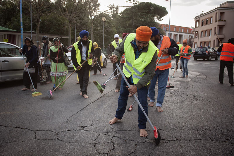 People working on street in city