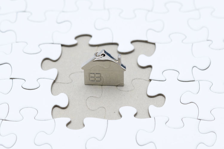 Backgrounds Close-up Complexity Connection Design Full Frame High Angle View Indoors  Jigsaw Piece Jigsaw Puzzle Leisure Activity Leisure Games No People Paper Pattern Puzzle  Relaxation Shape Solution Toy White Color