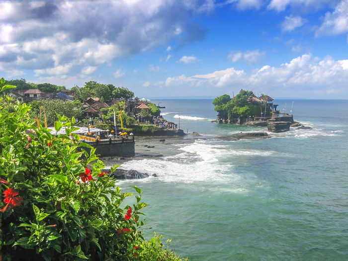 Tanah Lot Temple in Bali Indonesia - nature and architecture background Bali INDONESIA Architecture Beach Beauty In Nature Cloud - Sky Day Growth Horizon Over Water Nature No People Outdoors Plant Scenics Sea Sea And Sky Sky Tanah Lot Tourism Tranquil Scene Tranquility Travel Destinations Tree Vacation Water