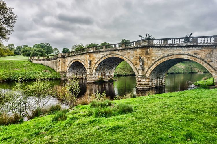 Paine's Bridge, Chatsworth, Derbyshire Arch Arch Bridge Beauty In Nature Built Structure Chatsworth Chatsworth House Cloud - Sky Connection Day Derbyshire Grass Green Color Growth Mr Darcy Nature No People Outdoors Paine's Bridge Pemberley Pride And Prejudice Sky Tranquil Scene Tranquility Tree