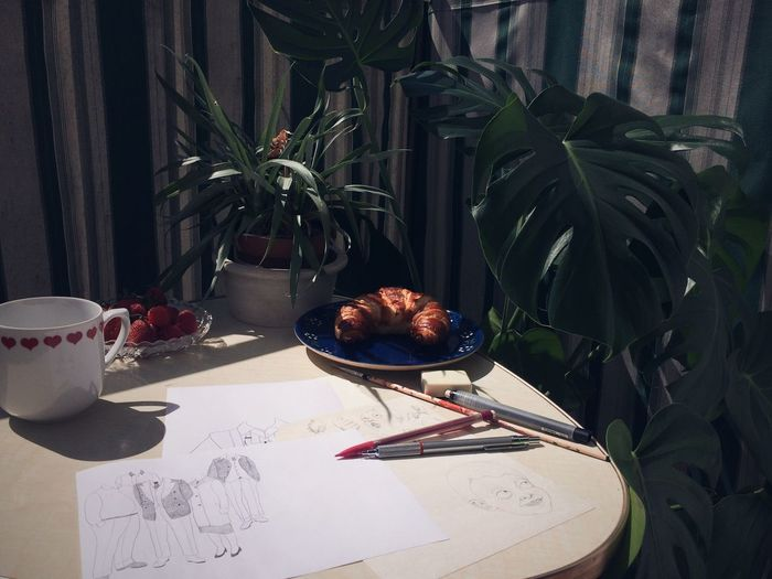 High angle view of drawing with food on table