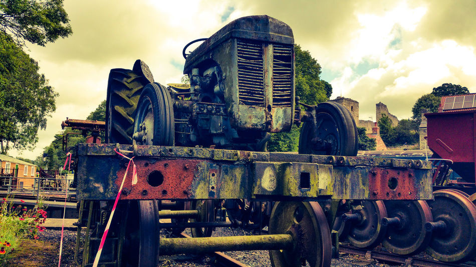 Rust EyeEmNewHere Rust Tractor Retro Derelict & Abandoned Decay History Train Steam Train Outdoors Sky Day No People Building Exterior